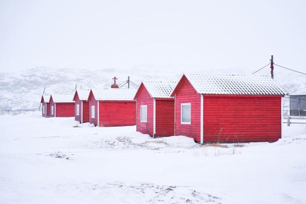 red-wooden-village-winter-landscape_71466-45